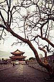 Chinese pagoda sits atop ancient Dali city wall, Dali City, Yunnan, China