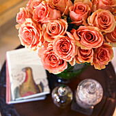 High angle view of orange roses in green vase on side table, Victoria, Vancouver Island, British Columbia, Canada