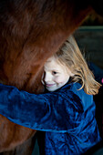 Young Girl Embracing Horse