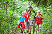 Multi generational family hiking through a wood, Styria, Austria