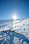 Ski and ski poles in snow, Laax, Canton of Grisons, Switzerland