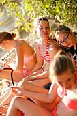 Four girls at lake Starnberg, Ammerland, Munsing, Upper Bavaria, Germany