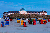 Spa Hotel at dusk, beach chairs, Juist Island, Nationalpark, North Sea, East Frisian Islands, East Frisia, Lower Saxony, Germany, Europe