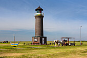 Lighthouse with horse and chart, Juist Island, Nationalpark, North Sea, East Frisian Islands, East Frisia, Lower Saxony, Germany, Europe