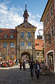 Pedestrians, outdoor cafe and Altes Rathaus city hall building, Bamberg, Franconia, Bavaria, Germany