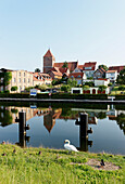 Canal with reflection of St. Mary`s Church, Plau am See, Mecklenburg-Western Pomerania, Germany