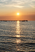 Pier at sunset, seaside resort of Kuehlungsborn at the Baltic Sea, Mecklenburg-Western Pomerania, Germany