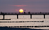 Pier at sunset, Seaside resort of Kuehlungsborn, Baltic Sea, Mecklenburg-Western Pomerania, Germany