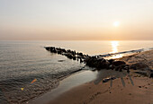 Old groynes in Kuehlungsborn West at sunrise, Seaside resort of Kühlungsborn, Baltic Sea, Mecklenburg-Western Pomerania, Germany