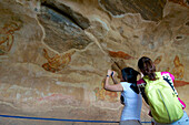 Asian tourists taking pictures of the Sigiriya Mamsells, frescoes on the rock, Sigiriya, Matale Distict, Cultural Triangel, Sri Lanka