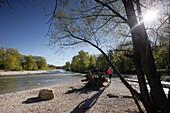 Female jogger, Isar river, Munich, Bavaria, Germany
