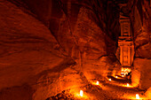 View through The Siq to Al Khazneh at night, Petra, Jordan, Middle East