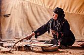 Bedouin woman baking bread, Wadi Rum, Jordan, Middle East