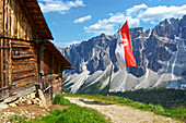 Furka alp with South-Tyrolian flag and view of Puez-Odle group, Val di Funes, Dolomiten Alps, South Tyrol, Upper Adige, Italy