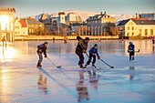 Playing ice hockey on the pond in Reykjavik, Iceland Tjornin is the Icelandic name for The Pond