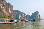 Old Boats and junkets Halong Bay Ha Long at ragged peaks and fishing villages mountains relax Vietnam