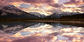 Mountain Range Reflected on Still Lake during Sunset at the Vermillion Lakes, Banff, Canada