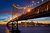 The San Francisco – Oakland Bay Bridge known locally as the Bay Bridge is a pair of bridges spanning San Francisco Bay of California, in the United States  As part of Interstate 80 and the direct road route between San Francisco and Oakland, it carries ap