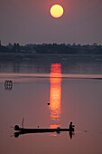 Fishing boat on the Mekong river at sunset in Vientiane, capital of Laos, Asia