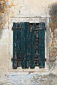 Old and weathered window shutter, Lakones, Corfu island, Ionian islands, Greece