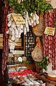 Sausages and ham in a delicatessen shop, Norcineria, Valnerina, valley of Nera river, Nurcia, Norcia, province of Perugia, Umbria, Italy, Europe