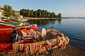 Fishing boats and fishing nets along the lake shore, Marta, Lago di Bolsena, crater lake of volcanic origin, province of Viterbo, Lazio, Italy, Europe