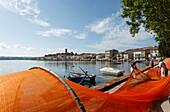 Fishermen and fish traps on the lake shore, Marta, Lago di Bolsena, crater lake of volcanic origin, province of Viterbo, Lazio, Italy, Europe