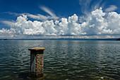 Cumulus clouds above lake Lago di Bolsena, Isola Martana im Hintergrund, crater lake of volcanic origin, near Montefiascone, province of Viterbo, Lazio, Italy, Europe