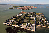 Aerial view of the island cemetery of San Michele, cemetery and grave yard of Venice, Burano in the background, Veneto, Italy