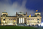 Illuminated building of German Reichstag in the evening, Berlin, Germany