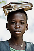 Schoolgirl carrying her books on her head, Malawi, Africa