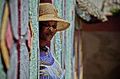 Woman of the Basotho tribe in front of her house, South Africa, Africa