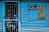 Woman sitting in her hut behind a barred door, Langa township, Cape Town, South Africa, Africa