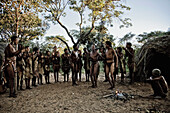 People of the San tribe dancing in their village around a fire, Otjozondjupa region, Namibia, Africa