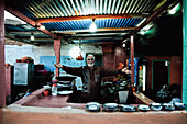 The landlord of a restaurant in his kitchen, Wadi Halfa, Sudan, Africa