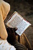 Pilgrim reading his prayer book, Lalibela, Ethiopia, Africa