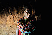 Young woman from the Samburu tribe in her hut, North Kenya, Kenya, Africa