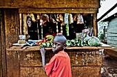Boy in front of a food shop, Buwenda, Uganda, Africa