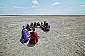 Massai's sitting in a circle in the plains, Ngorongoro, Tanzania, Africa