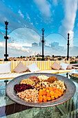 Nuts and dried fruit appetizer, rooftop restaurant with view over the city, Istanbul, Turkey