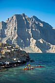 Kayaking excursion to Telegraph Island in the fjord of Musandam Peninsula, near Khasab, Oman