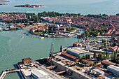 Aerial view of the Venetian Arsenal with shipyards, armories and docks, Isola San Pietro and San Elena in the background, Navy, Venice, Veneto, Italy