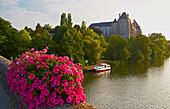 View of Abbaye Saint-Pierre-de-Solesmes, Solesmes, Houseboat on the river Sarthe, Dept. Sarthe, Region Pays de la Loire, France, Europe