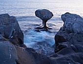 Kannesteinen, mushroom shaped rock formation in Oppedal, Vagsoy Island, Province of Sogn og Fjordane, Vestlandet, Norway, Europe