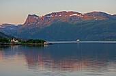 MS Nordkapp of the, Hurtigruten at Vagsfjord near Maloy in the first morning light, Province of Sogn og Fjordane, Vestlandet, Norway, Europe