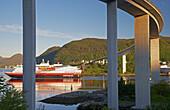 MS Nordnorge of the Hurtigruten in Ulvesund under Maloy bridge, Vagsoy Island, Province of Sogn og Fjordane, Vestlandet, Norway, Europe