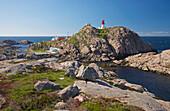Lighthouse and house on rocks at Kap Lindesnes, Province of Vest-Agder, Soerlandet, Norway, Europe