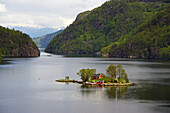 Island with red house at Lovrafjord near Sand at RV 13, Province of Rogaland, Vestlandet, Norway, Europe