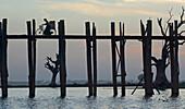 Vendor with bicycle on the U Bein bridge, 1,2 km long wooden bridge, Amarapura near Mandalay, Myanmar, Burma