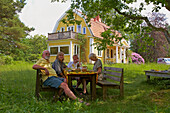 Lunch in the garden, Vaestra Bodarne, Mjoern, Province of Bohuslaen, West coast, Sweden, Europe